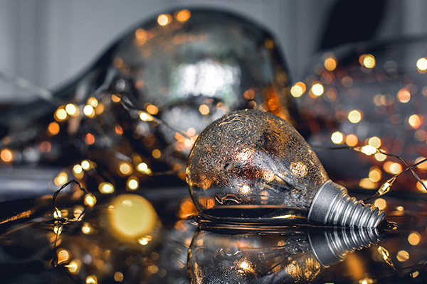 lamp surrounded by sparkling lights